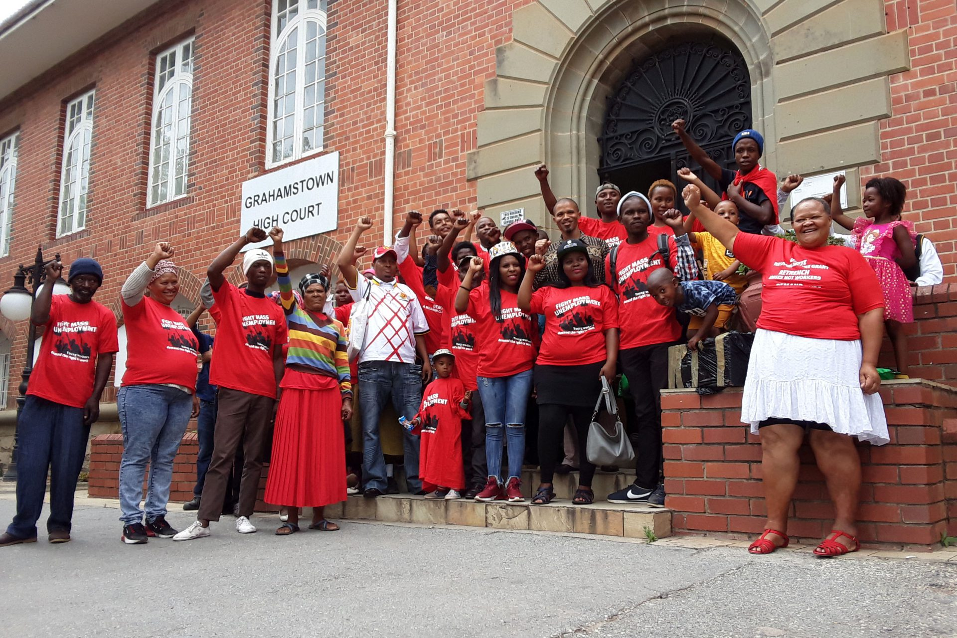 Members of the Unemployed Peoples Movement celebrate the Makhanda High Court ruling that the Makana municipality must be dissolved. (Photograph by Anna Majavu, New Frame)